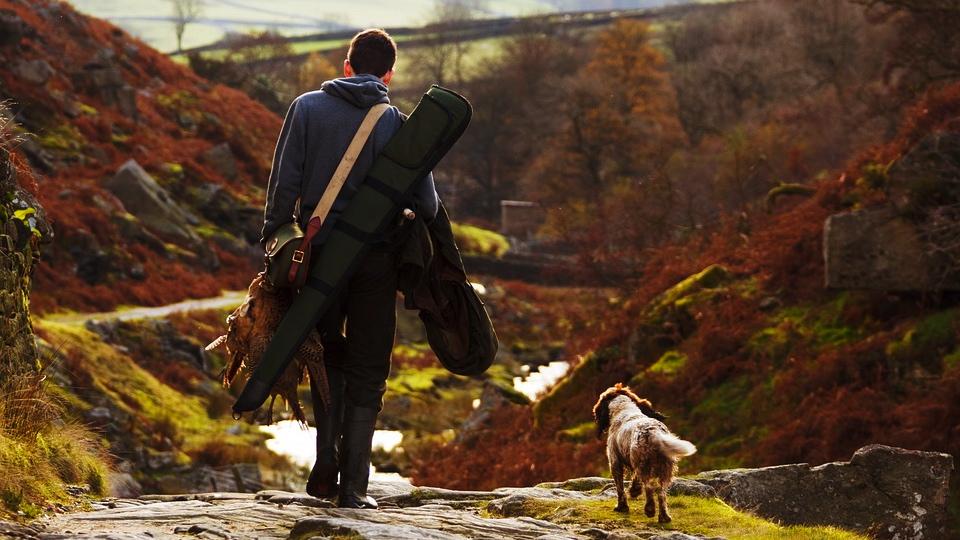 Hunter with dog courtesy of Pixabay